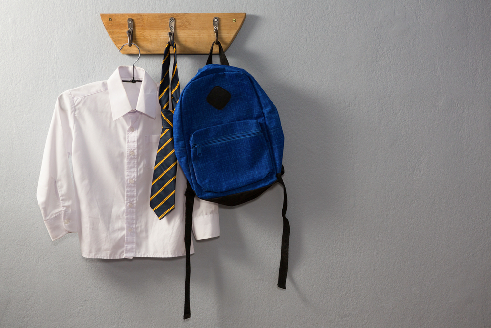 school uniform hanging on a hook