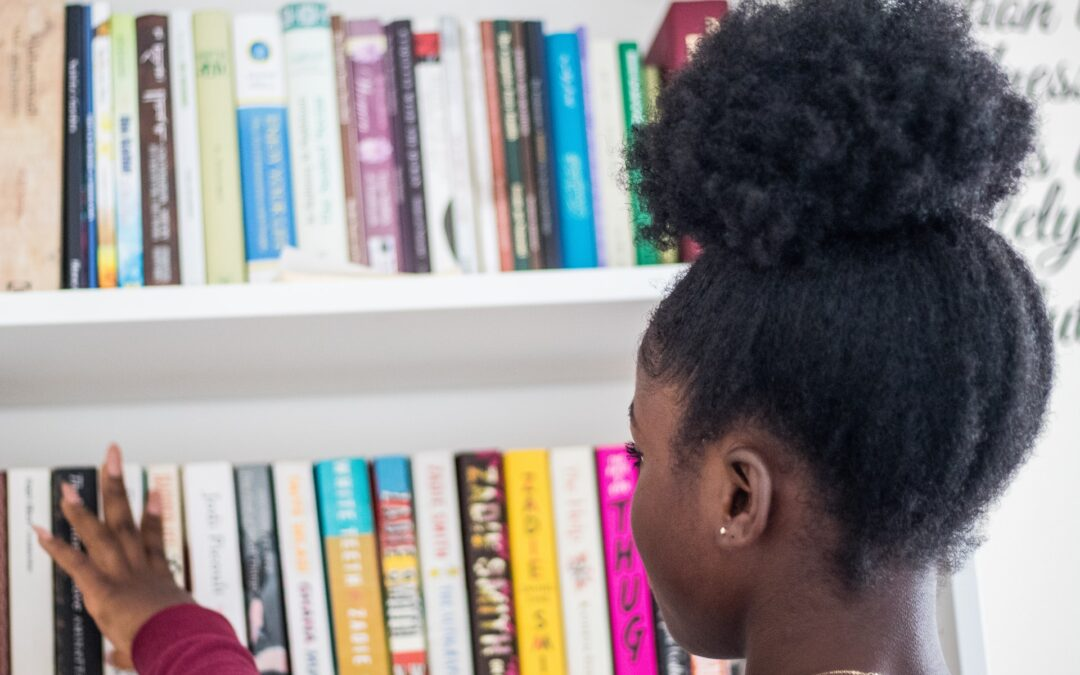child looking at books in a library